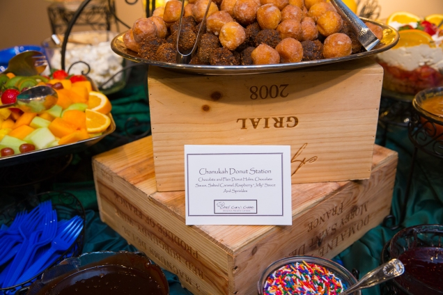 chanukah donut station with caterer sign