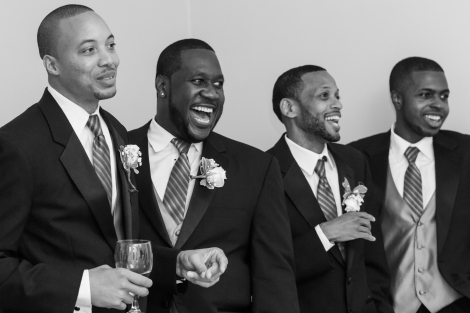 happy groomsmen b&w